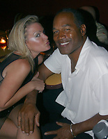 EXCLUSIVE <br /> Miami Beach, FL 6-13-2002<br /> OJ Simpson is back with girlfriend<br /> Christy Prody at a birthday party for<br /> friend Tammy Wu at RUMI RESTAURANT.<br /> Photo by Adam Scull-PHOTOlink
