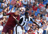 Calcio, Serie A: Roma vs Udinese. Roma, stadio Olimpico, 20 agosto 2016.<br /> Roma's Leandro Paredes, left, and Udinese's Duvan Zapata jump for the ball during the Italian Serie A football match between Roma and Udinese at Rome's Olympic Stadium, 20 August 2016. Roma won 4-0.<br /> UPDATE IMAGES PRESS/Riccardo De Luca