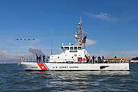"""The USCG cutter """"Hawksbill"""" (WPB-87312) patrols San Francisco Bay as the Blue Angels in line abreast formation pass over the bow."""