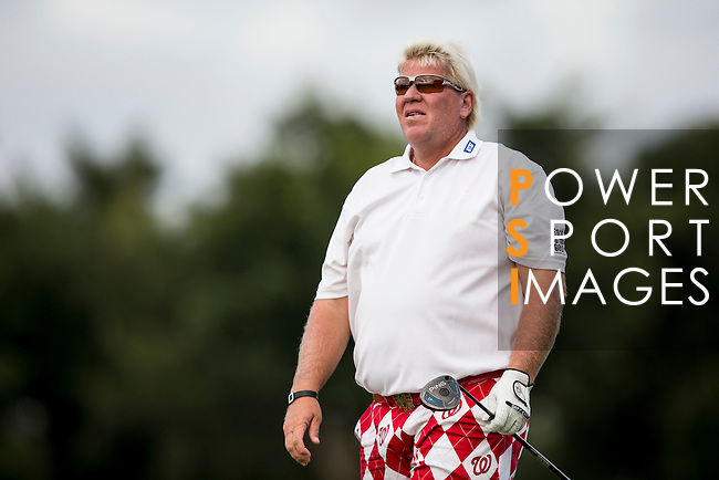 John Daly tees off the 14th hole of the World Celebrity Pro-Am 2016 Mission Hills China Golf Tournament on 21 October 2016, in Haikou, China. Photo by Victor Fraile / Power Sport Images
