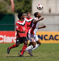 Christoper Nanco (11) of Canada moves in on Adan Noel (5) of Trinidad & Tobago during the quarterfinals of the CONCACAF Men's Under 17 Championship at Catherine Hall Stadium in Montego Bay, Jamaica. Canada defeated Trinidad & Tobago, 2-0.