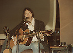 Neil Young 1982 Madison Square Garden , New York.  Playing a Taylor 855 12 String Acoustic.