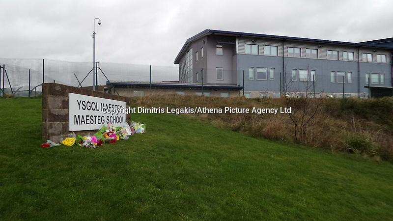 COPY BY TOM BEDFORD<br /> Pictured: Flowers and tributes left at the school sign outside Maesteg Comprehensive School in south Wales. Thursday 11 December 2014<br /> Re: Inquest into the death of teenager Ashley Daniel Talbot held at Aberdare Coroner's Court.<br /> Ashley, 15, died at the scene and another boy, 13, suffered minor injuries in December 2014, following a crash involving a school minibus en route to a rugby match,at Maesteg Comprehensive School in south Wales.