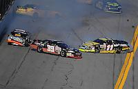 Feb 7, 2009; Daytona Beach, FL, USA; ARCA RE/MAX Series drivers Brett Butler (14) Michael Phelps (39) and Bryan Silas (11) crash during the Lucas Oil Slick Mist 200 at Daytona International Speedway. Mandatory Credit: Mark J. Rebilas-