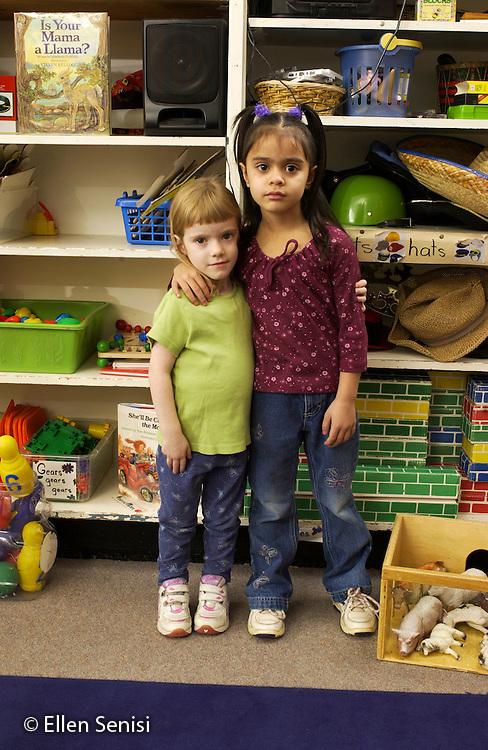 MR / Schenectady, NY                                  .Yates Arts-in-Education Magnet School (urban school).Pre-Kindergarten classroom; NYS Universal Pre-K Program.Two girls, same age, different sizes.  Girl left: 4; girl right: 4, Puerto-Rican American..Mor8   Val1.©Ellen B. Senisi