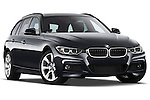 Low aggressive passenger side front three quarter view of a 2013 BMW 330d Touring Wagon