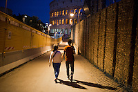 A couple walks back towards the Colosseum on Tuesday, Sept. 22, 2015, in Rome, Italy. (Photo by James Brosher)