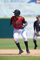 Jose Almonte (9) of the Hickory Crawdads takes his lead off of second base against the Charleston RiverDogs at L.P. Frans Stadium on May 13, 2019 in Hickory, North Carolina. The Crawdads defeated the RiverDogs 7-5. (Brian Westerholt/Four Seam Images)