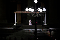 Pope Francis  during Good Friday's Way of the Cross (Via Crucis) at St. Peter's Square in The Vatican on April 10, 2020, during the lockdown aimed at curbing the spread of the COVID-19 infection, caused by the novel coronavirus.