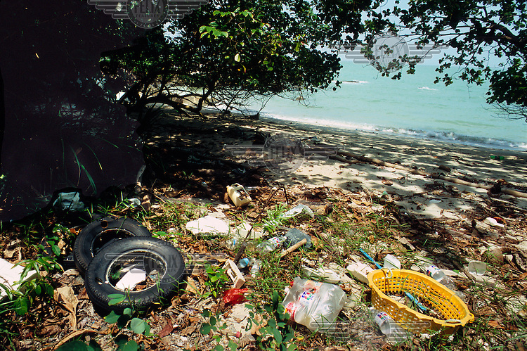 Car tyres, plastic bottles and other rubbish pollute a beach in the Pantai Aceh Forest Reserve.