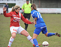 AA Gent Ladies - RAEC Mons : Vanessa Kerckhofs met de tackle (links).foto Joke Vuylsteke / Vrouwenteam.be
