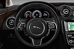 Car pictures of steering wheel view of a 2016 Jaguar XJ Premium Luxury 4 Door Sedan Steering Wheel