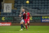 27th March 2021; Dens Park, Dundee, Scotland; Scottish Championship Football, Dundee FC versus Dunfermline; Liam Fontaine of Dundee heads clear from Euan Murray of Dunfermline Athletic
