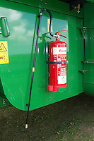 Fire extinguisher fitted to a John Deere combine