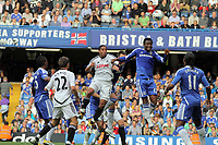 Pictured L-R: Battling for  a header Ashley Williams of Swansea against Mikel of Chelsea. Saturday 17 September 2011<br />