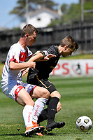 Andrew Bevin of Team Wellington competes for the ball with Shuiab Khan of Waitakere United during the  ISPS Handa Men's Premiership - Team Wellington v Waitakere Utd at David Farrington Park,Wellington on Saturday 30 January 2021.<br /> Copyright photo: Masanori Udagawa /  www.photosport.nz