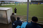Port Talbot Town 3 Caerau Ely 0, 06/02/2016. Genquip Stadium, Welsh Cup fourth round. Spectators behind the away dugout watching as Port Talbot Town (in blue) play host to Caerau Ely in a Welsh Cup fourth round tie at the Genquip Stadium, formerly known as Victoria Road. Formed by exiled Scots in 1901 as Port Talbot Athletic, they competed in local and regional football before being promoted to the League of Wales  in 2000 and changing their name to the current version a year later. Town won this tie 3-0 against their opponents from the Welsh League, one level below the welsh Premier League where Port Talbot competed, watched by a crowd of 113. Photo by Colin McPherson.