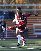 Boston College midfielder/defender Atobra Ampadu (6) follows through on a shot. Boston College (maroon) defeated Virginia Tech (Virginia Polytechnic Institute and State University) (white), 3-1, at Newton Campus Field, on November 3, 2013.