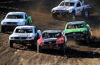 Nov. 6, 2010; Las Vegas, NV USA; LOORRS super lite driver Dawson Kirchner (16) leads Kyle Leduc (24) and Chad George (42) during round 13 at the Las Vegas Motor Speedway short course. Mandatory Credit: Mark J. Rebilas-