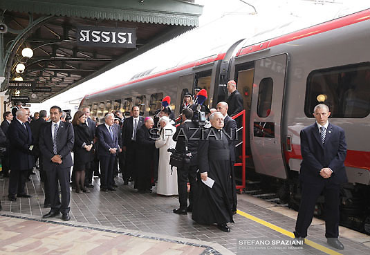 """Pope Benedict XVI disembarks from a train in Assisi station upon arrival to attend the interreligious talks, a """"journey of reflection, dialogue and prayer for peace and justice in the world"""" held in St. Francis of Assisi's birthplace,  October 27, 2011 in Assisi.Italy"""