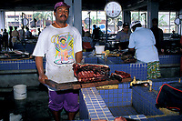 butcher chops up meat from blackfish or shortfin pilot whale, Globicephala macrorhynchus, at Kingston Fish Market, St. Vincent, West Indies Saint Vincent and the Grenadines ( Caribbean )