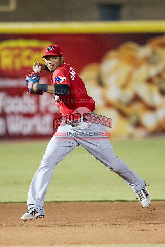 Frisco Roughriders shortstop Luis Sardinas (2) makes a running throw to first base in the Texas League baseball game against the San Antonio Missions on August 22, 2013 at the Nelson Wolff Stadium in San Antonio, Texas. Frisco defeated San Antonio 2-1. (Andrew Woolley/Four Seam Images)
