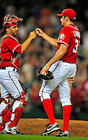 6 June 2009: Washington Nationals' pitcher John Lannan gets congratulated by catcher Wil Nieves after throwing a complete-game 4-hitter against the New York Mets at Nationals Park in Washington, DC. The Nationals defeated the Mets 7-1, marking Lannan's first complete game of his career. Mandatory Credit: Ed Wolfstein Photo