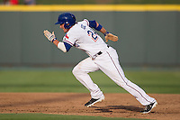 Round Rock Express outfielder Jim Adduci (24) sprints to second base during the Pacific Coast League baseball game against the Salt Lake Bees on August 10, 2013 at the Dell Diamond in Round Rock, Texas. Round Rock defeated Salt Lake 9-6. (Andrew Woolley/Four Seam Images)
