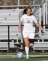 College of St Rose forward Laura Taylor (21) looks to pass.. In 2012 NCAA Division II Women's Soccer Championship Tournament First Round, College of St Rose (white) defeated Wilmington University (black), 3-0, on Ronald J. Abdow Field at American International College on November 9, 2012.