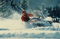 Man (MR) snowmobiling, Summit County, CO. Summit County, Colorado.