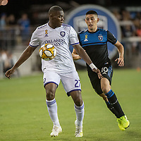 SAN JOSE,  - SEPTEMBER 1: Kamal Miller #27 of the Orlando City SC and Cristian Espinoza #10 of the San Jose Earthquakes during a game between Orlando City SC and San Jose Earthquakes at Avaya Stadium on September 1, 2019 in San Jose, .