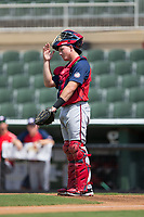 Hagerstown Suns catcher Jakson Reetz (48) gives defensive signals to his infield during the game against the Kannapolis Intimidators at Kannapolis Intimidators Stadium on July 9, 2017 in Kannapolis, North Carolina.  The Intimidators defeated the Suns 3-2 in game one of a double-header.  (Brian Westerholt/Four Seam Images)
