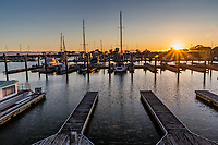 The setting sun glows on the few boats and the many empty berths at the San Leandro Marina on the eastern shores of San Francisco Bay.