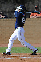 Michael Gonzalez #6 of East Tennessee State University follows through on a swing at Greenwood Field against the the University of North Carolina Asheville on March 2, 2011 in Asheville, North Carolina.  East Tennessee State University won 13-5.  Photo by Tony Farlow / Four Seam Images..