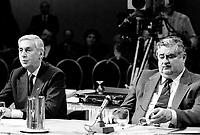 Montreal ,  Canada- File -  Andre Chagnon, Videotron (L), Roland Giguere, Tele-Metropole (R) attend the CRTC Hearing, Dec 1, 1986.