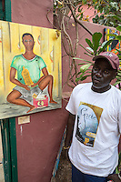 Dakar Artist Bakary Diop and one of his Paintings--Young Man with his Islamic Prayer Board, Goree Island, Senegal