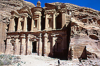"""Jordan. Petra.The archeological site is part of the UNESCO world heritage project.  The Nabataeans were an arabian industrious tribe which settled down in southern Jordan 2000 years ago. Petra is located at the bottom of a spectacular deep gorge surrounded by mountains. """" Al-Dayr"""" monastery. Its high façade is carved in the rocks.  German tourists looking at the height and the beauty of the building. © 2002 Didier Ruef"""