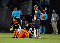 LAKE BUENA VISTA, FL - JULY 18: Memo Rodríguez #8 of the Houston Dynamo is attended to by the training staff during a game between Houston Dynamo and Portland Timbers at ESPN Wide World of Sports on July 18, 2020 in Lake Buena Vista, Florida.