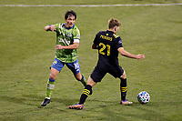 COLUMBUS, OH - DECEMBER 12: Nicolas Lodeiro #10 of Seattle Sounders FC battles for the ball against Aidan Morris #21 of Columbus Crew during a game between Seattle Sounders FC and Columbus Crew at MAPFRE Stadium on December 12, 2020 in Columbus, Ohio.