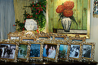 Imelda Marcos, famous people in photo frames, in her Appartment