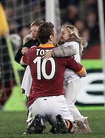 Calcio, Serie A: Roma vs Genoa. Roma, stadio Olimpico, 3 marzo 2013..AS Roma forward Francesco Totti greets his children Cristian, left, and Chanel, at the end of the Italian Serie A football match between AS Roma and Genoa at Rome's Olympic stadium, 3 March 2013..UPDATE IMAGES PRESS/Riccardo De Luca