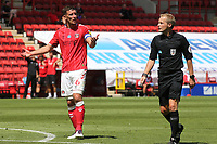 Jason Pearce of Charlton shows his frustration after referee, Gavin Ward, allows the game to continue rather than give a penalty to Charlton during Charlton Athletic vs Wigan Athletic, Sky Bet EFL Championship Football at The Valley on 18th July 2020
