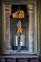 Cambodia, Angkor Wat.  Vishnu Statue inside the Western Entrance to the Temple.