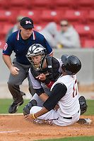 Sean Henry #17 of the Carolina Mudcats slides in ahead of the tag by Brad Davis #6 of the Jacksonville Suns at Five County Stadium May 18, 2009 in Zebulon, North Carolina. (Photo by Brian Westerholt / Four Seam Images)