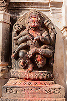 Bhaktapur, Nepal.  Stone Sculpture Showing Narasimha, Man-lion Avatar of Vishnu, Victorious over the Demon Hiranyakasipu.  Outside entrance to the National Art Gallery, Durbar Square.