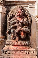 Bhaktapur, Nepal.  Stone Sculpture Showing Narasimha, Man-lion Avatar of Vishnu, Victorious over the Demon Hiranyakasipu.  Outside entrance to the National Art Gallery, Durbar Square.
