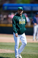 Beloit Snappers pitching coach Carlos Chavez (35) walks back to the dugout after a mound visit during a game against the Bowling Green Hot Rods on May 7, 2017 at Pohlman Field in Beloit, Wisconsin.  Bowling Green defeated Beloit 6-2.  (Mike Janes/Four Seam Images)