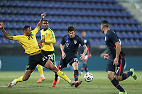 WIENER NEUSTADT, AUSTRIA - MARCH 25: Ethan Pinnock #21 of Jamaica and Christian Pulisic #10 of the United States during a game between Jamaica and USMNT at Stadion Wiener Neustadt on March 25, 2021 in Wiener Neustadt, Austria.