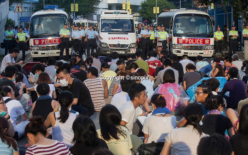 Pro-democracy students face off with the police, next to the Hong Kong government headquarters in Hong Kong's downtown district, on the first day of the mass civil disobedience campaign Occupy Central, Hong Kong, China, 28 September 2014.