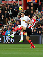 Pictured L-R: Neil Taylor of Swansea challenged by Dusan Tadic of Southampton Sunday 01 February 2015<br />